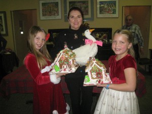 Sarah & Skye show off their gingerbread creations while their Aunt Patricia holds Em!